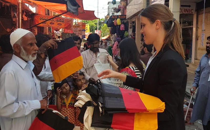 Islamabad German Embassy staff distributes cloth bags after plastic ban