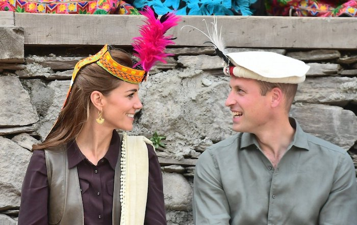 The Duchess and Duke of Cambridge wear a head dress and hat bestowed on them by members of the Kalash tribe in Chitral, Pakistan. Photo: EPA-EFE