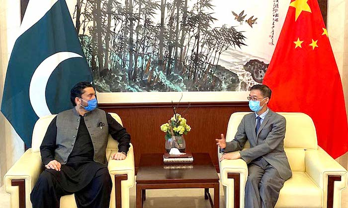 ISLAMABAD: April 30 - Minister of State for SAFRON Shehryar Afridi meets Chinese Ambassador Yao Jing at Chinese Embassy to recieve ration packages for Afghan refugees. APP